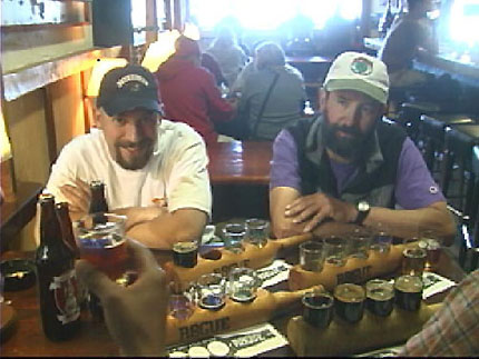 The filmmakers enjoy some palate bruisers with brewmaster John C. Maier (right) at Rogue Brewery on the Oregon coast. in American Beer