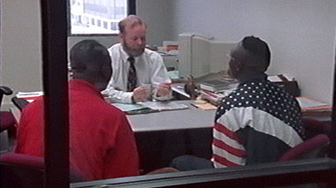 An applicant in a political-asylum interview at the New York Immigration office. in Well-Founded Fear